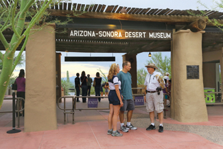 A docent greets guests at the museum entrance